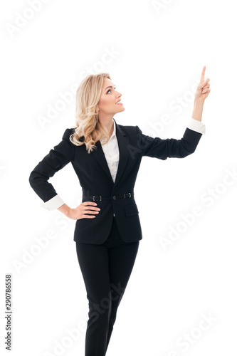 Happy smiling businesswoman, showing something, some product or blank copyspace area for advertise slogan or text message, over white background