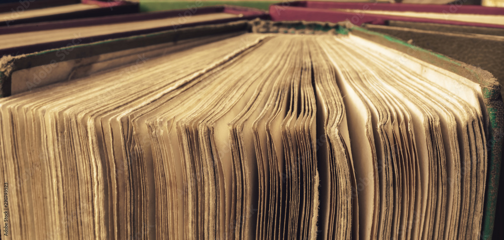 Fototapety, obrazy: Close up open old page books on a background table. Macro view.