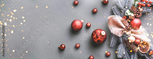 Fototapeta  Christmas wreath with another festive decor and flickering lights