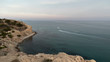 Mediterranean sea from a cliff with a view of a boat and a water scooter