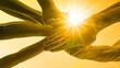canvas print picture - viele aufeinander gestapelte Hände - Hintergrund gelber Himmel mit Sonne