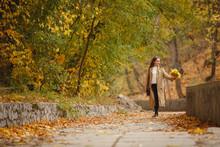Autumn Mood. Romantic Woman We...