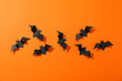 canvas print picture - Flat lay with decorative bats on orange background, copy space