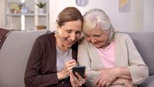 Cheerful Old Women Watching Ph...