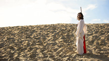 Hermit With Staff Walking In Desert Looking To Camera, Asceticism And Fasting