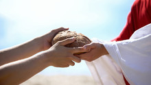 Jesus Hands Giving Bread To Po...