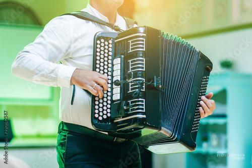Adult man plays the button accordion Tapéta, Fotótapéta