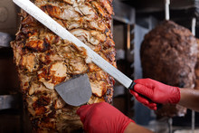 Fried Meat On A Skewer For Cooking Of Donors Or Shawarma. Close-up