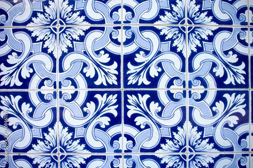 Photo Typical portuguese wall ceramic titles azulejo blue and white ornament