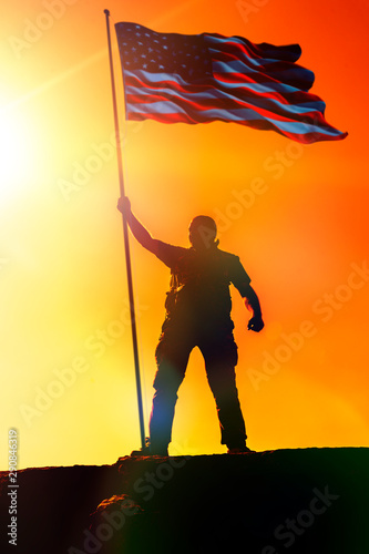 Photo  Silhouette of man holding US flag American on the mountain
