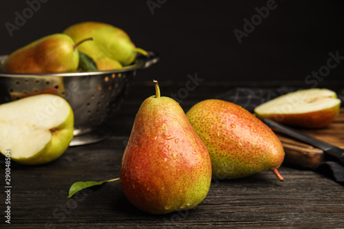 Ripe juicy pears on dark wooden table against black background Tapéta, Fotótapéta