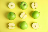 Flat lay composition of fresh ripe green apples on yellow background
