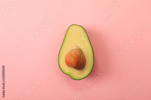 Half of delicious avocado on pink background, top view - 290849398