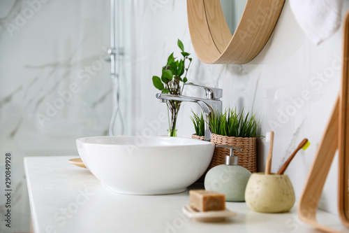 Photo Modern bathroom interior with vessel sink and decor elements