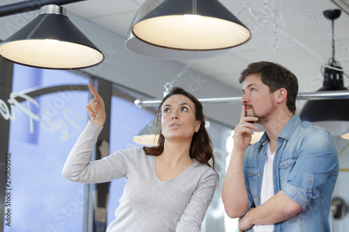 couple looking at overhead lighting