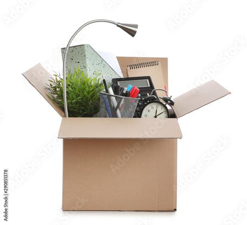 Photo Cardboard box full of office stuff on white background