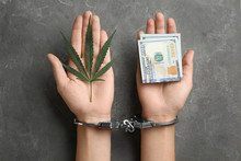 Woman In Handcuffs Holding Hemp Leaf And Dollars On Grey Stone Background, Closeup