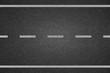 canvas print picture - White lines on asphalt road