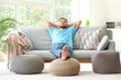 canvas print picture - Handsome young man relaxing at home