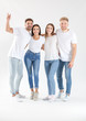 canvas print picture - Group of young people in stylish casual clothes on white background