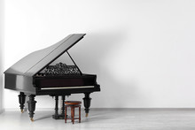 Black Grand Piano Near White W...