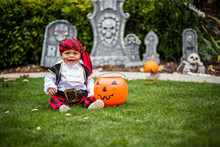 Cute Young Child In A Halloween Costume Ready To Trick Or Treat
