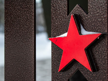 The Red Five-pointed Metal Star Is A Symbol Of The Soviet Union And The Soviet Army, A Close-up Soviet Star