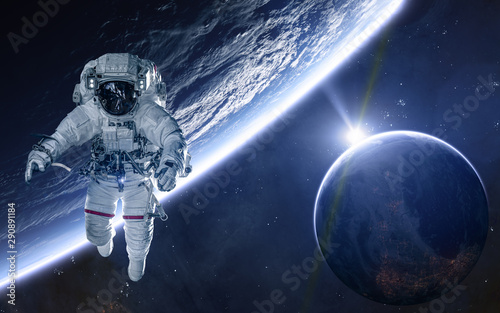 Fototapeta  Astronaut on background of planets of deep space