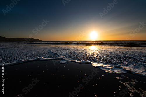 Photo  Sunset and landscape of widemouth bay near bude cornwall