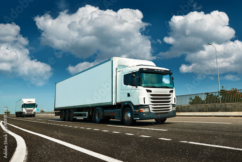 Cuadros en Lienzo  White truck is on highway - business, commercial, cargo transportation concept,