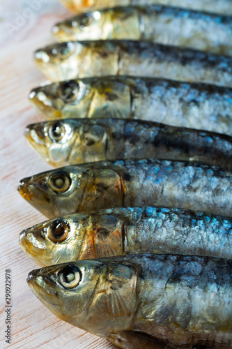 Salted and pressed sardines on wooden table