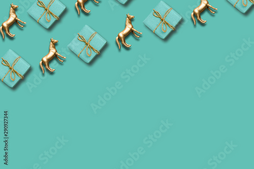 Fototapeta gift box and gold horse pattern composition. christmas or holiday background obraz