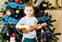Little Boy Plays The Guitar Ne...