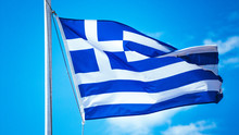 Greek Flag Waving On The Blue ...