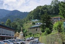 Car Parking Near A Monestary Over The Mountain In Sikkim, India