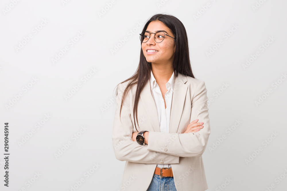 Fototapeta Young business arab woman isolated against a white background smiling confident with crossed arms.
