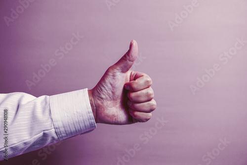 Businessman's hand showing good.   グッドを表すビジネスマンの手 Wallpaper Mural