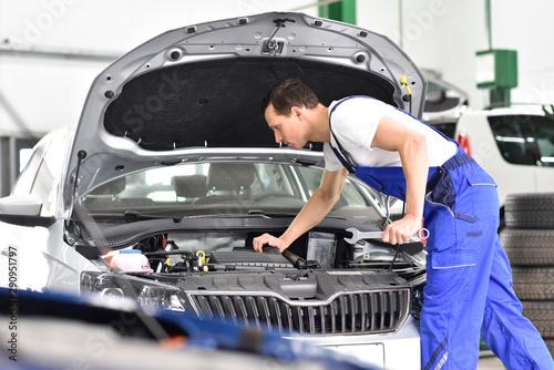 car mechanic in a workshop repairing a vehicle Fototapeta