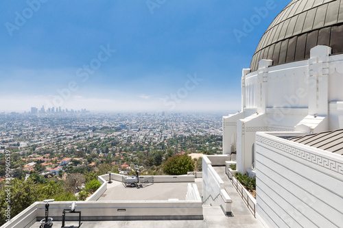 Wide angle view of a white terrace overlooking the city of Los Angeles in a sunn Wallpaper Mural