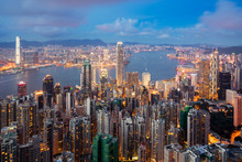 Hong Kong In Kowloon Area Skyline View From Victoria Peak In Hong Kong. Asian Tourism, Modern City Life, Or Business Finance And Economy Concept.