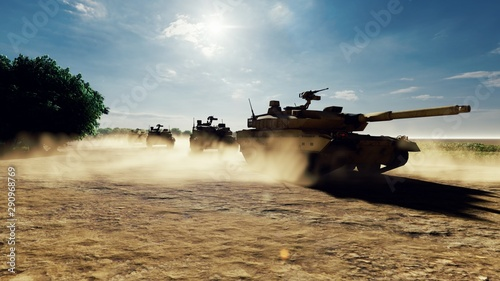 Photo Military tanks ride on a dusty road on a Sunny day on the battlefield
