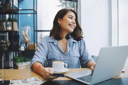 Fotografie, Obraz  businesswoman working on laptop in office
