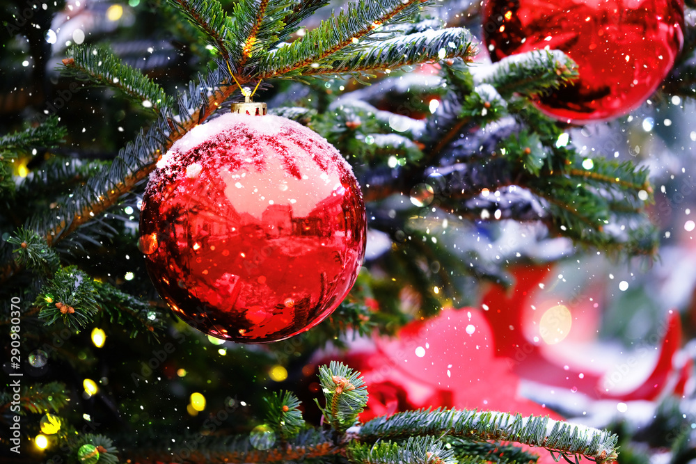Fototapety, obrazy: red ball, symbol of christmas and new year.  Bright red balls hanging on fir branches, winter natural snowy background. abstract festive winter holiday background. soft selective focus