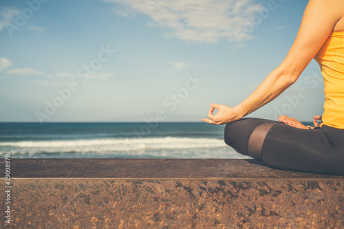 Foto auf AluDibond Cappuccino Yoga girl meditating and relaxing in yoga pose, ocean view