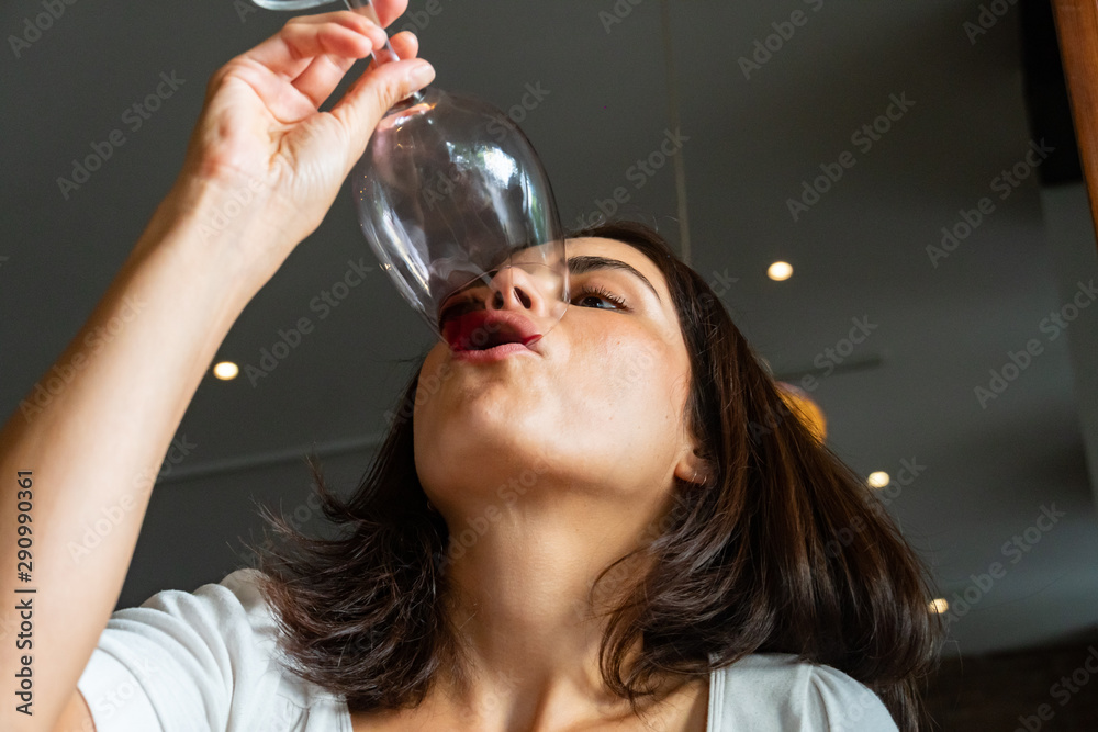 Fototapety, obrazy: Brunette woman drinking red wine