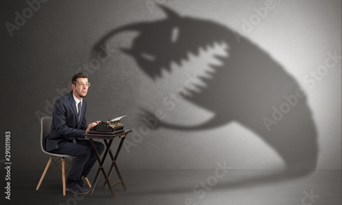 Little hard worker afraid of scary monster shadow Canvas Print