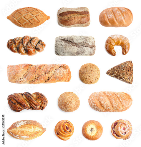 Set with different fresh loaves of bread and pastries on white background, top view