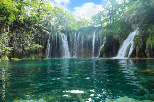 Fotografie, Obraz  Picturesque view of beautiful waterfall and lake on sunny day