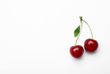 Delicious ripe sweet cherries with leaf on white background