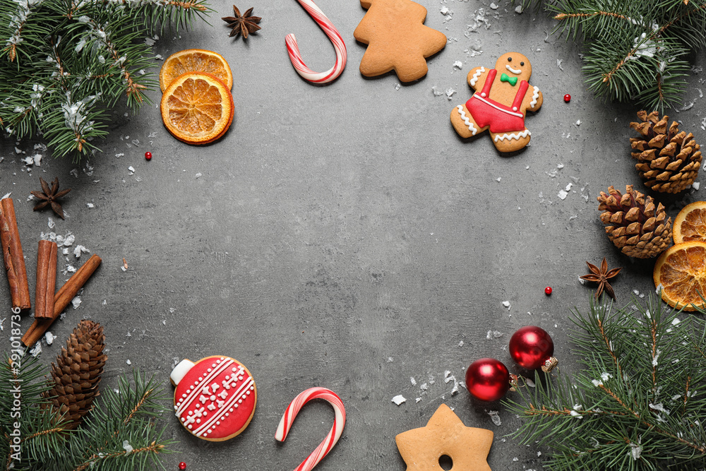 Fototapeta Frame made with tasty homemade Christmas cookies on grey table, flat lay. Space for text